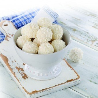 White chocolate coconut truffles in bowl. Selective focus